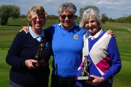 At Selsey are Sheila Watmore, right and Rita Green, left, winners of the Centenary Foursomes with Carol Wheeler, Lady Captain