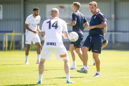 Hawks striker Danny Kedwell, right, picked up an injury on Saturday and will miss the Bognor friendly. Picture: Habibur Rahman