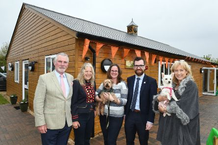 Jerry Green Rescue Centre opens new centre. L-R Trustees of The Pawprint, John and Victoria Taylor who opened the building, Lynn Hewison, Paul McCartan and Jayne Chudley - trustees of Jerry Green. Pictured with dogs Tigger and Narla. EMN-190521-094647005