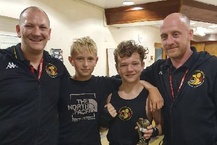 Harvey Harmon is pictured post-fight with Alfie Briggs and coaches Scott Harmon and Matthew Mooney.
