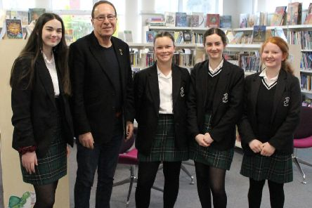 Peter James with students from Millais