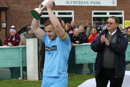 Ardley United captain Luke Cray with the trophy NNL-170105-125325002