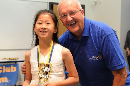 Buckingham and Winslow rotary club's budding musician competition at The Sir Thomas Fremantle School, Winslow.'The Under 12 years section - under 12s winner and overall budding musician winner Jessie Jiao with Buckingham Rotary Club president David Barnes.