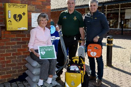 Buckingham AED project lifting cushion - from left Valerie Shaw, Richard Watkins, community first responder and Lee King, AED project chairman