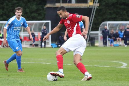 Brackley Town's Thierry Audel comes away with the ball against Chester. Photo: Steve Prouse