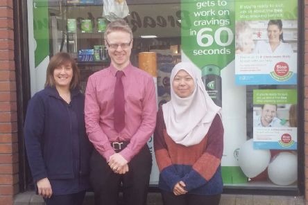 Staff pictured outside McCoubrey and Woodside's Pharmacy in Larne.