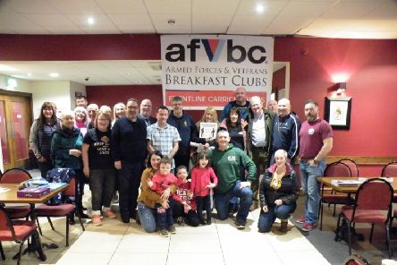 The Frontline Breakfast Club, Carrickfergus, proudly celebrated its first anniversary recently. Members were joined by Whitehead Royal British Legion, Tab4THEFALLEN11 and actorr and veteran supporter Charlie Lawson, who unveiled their new Armed Forces Veterans Breakfast Club banner.