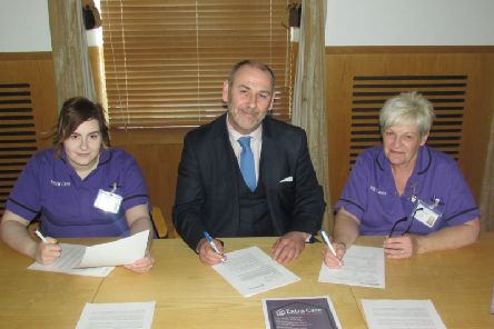 Brian Hutchinson, CEO Extra Care,  with care workers Sarah-Louise Connor (left) and Iris Connor.