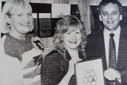 Joan Carleton, Cancer Research Campaign, and Dennis Irwin (chair of the Carrick Committee for the Campaign) present a bronze certificate of appreciation to Dawn Irsin for her work on behalf of the Committee. 1991