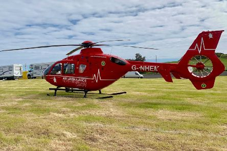 The Air Ambulance attends the NW 200 in Portstewart today, 12 May 2019, after a casualty was reported to have fallen from a height.