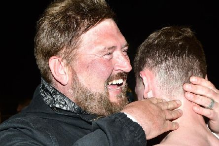 Carrick Rangers boss Niall Currie celebrating with his players following promotion back into the Danske Bank Premiership.