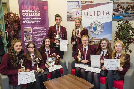 Ulidia prize winners proudly display their awards.