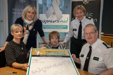 Amanda Stewart, Chief Executive, Northern Ireland Policing Board, Detective Chief Superintendent Paula Hilman, Head of Public Protection Branch, Rosemary Magill Chief Executive, Women's Aid ABCLN, Assistant Chief Constable Barbara Gray, Crime Operations Department and Chief Constable Simon Byrne signing the White Ribbon Charter pledging never to commit, condone or remain silent about violence against women.