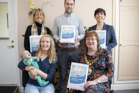 Back row, Juliet Coulter, Principal Environmental Health officer, John Robb, Community Health and Wellbeing advisor and father of Eli and Rhonda McIlroy, registrar; front row, Emma Robb, baby Eli and the Mayor of Mid and East Antrim, Cllr Maureen Morrow.