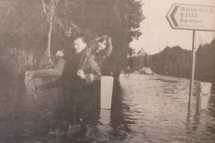 Gallant Philip Fogden gives Debbie Lawrence a lift through the flood at North End Road, near Barnham