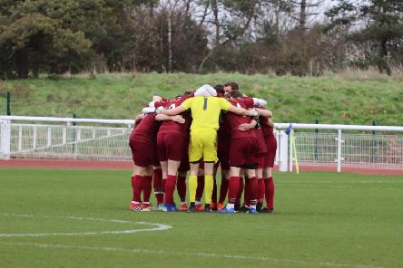 The Bognor huddle at Enfield - now the squad have been hit by more injuries / Picture by Little James Photography.