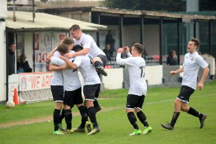 Pagham celebrate a goal - but they ended up on the losing side / Picture by Roger Smith
