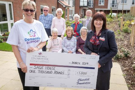 The official cheque presentation to staff of Saga House