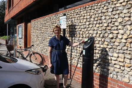 Penny Plant Cabinet Member for the Environment and Chichester Contract Services at Chichester District Council with an electric vehicle charging point