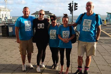 Alongside her cousin Milly Bool (second, left), uncle Warren Bool (left), uncle Mike White (right) and friend Lisa Guster (middle),Lucy Cobb (second,right) walked from Bognor to Brighton