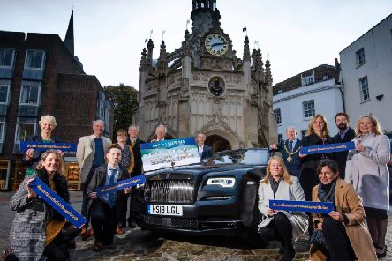 Councils, organisations and local media organisations gather at the Market Cross with a Rolls Royce car to launch the campaign.