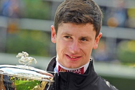 Oisin Murphy with his champion jockey trophy / Picture by Malcolm Wells