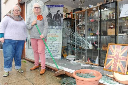 Emsworth Antiques Etc, in West Street, Emsworth, had a car reverse into their shop window on Monday, November 4.......Pictured is: (l-r) Hilary Bolt, owner and Lisa Marie Wood, shopkeeper.......Picture: Sarah Standing (041119-1085)