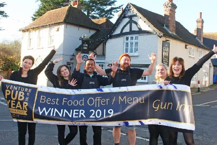 Sally Harris, manager, right, with the team outside The Gun Inn. Picture: Derek Martin DM19120349a