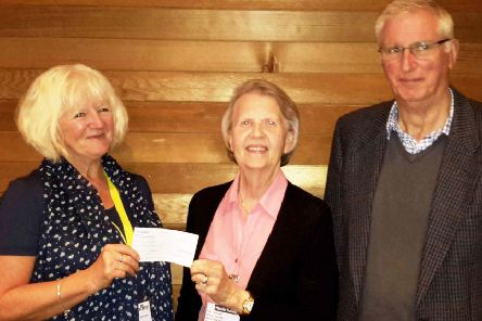 Macular Society regional manager Stella Black, left, accepts the cheque from Pat Clemow and Nick Le Mare
