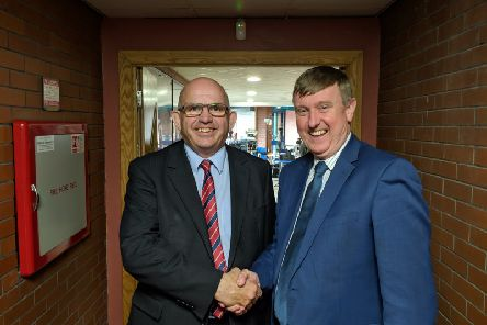 DUP MLA Mervyn Storey (right) congratulates party colleague John Finlay on holding on to his seat in Causeway Coast and Glens Council