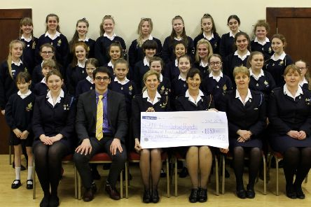 Ballywatt GB Company section presents the giant cheque for the Uganda School Project to Heather Sweet, GBNI Vice President. [photograph by Kirsty Caldwell]