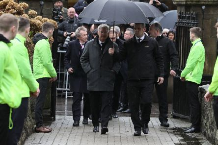 Denis Law and Sir Alex Ferguson arrive for the funeral of former Manchester United and Northern Ireland goalkeeper Harry Gregg, at St Patrick's Parsh Church, Coleraine. PA Photo.
