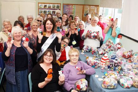 Littlehampton knitters present more than 5,000 little hats to Age UK for The Big Knit with innocent. Photo by Derek Martin DM1951033a