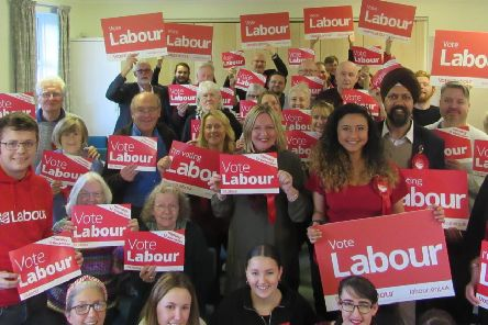Gemma Bolton, red top wearing the rosette, is standing as Labour candidate for Mid Sussex