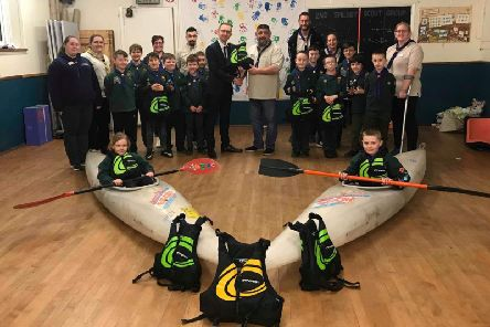 """Pictured with the 2nd Spilsby Cub Pack. at the presentation are Pictured in the photograph are (from left) Bethany Holland, Cub Leader, Sarah Baumber, District Commissioner  for Skegness and Spilsby district., Suzy Pearl, Cub Leader, Anthony Sansom, Group Section Assistant,Councillor Morgan Holland, Wayne Pearl """"Akela"""", Cub Leader, 'Jon Kirkham, Scout Leader, Alexis Smith, Scout Leader, Gemma Holland, Group Scout Leader for 2nd Spilsby,"""