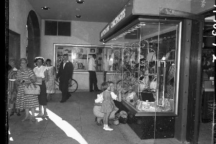 A mother and her daughter window shopping in Boots new store on the corner of Gold Street and Drapery, Northampton, on September 12, 1959