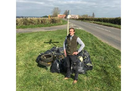 Joe Adams is pictured with one-tenth of the 181 bin bags of rubbish - this haul was collected in one day on 300 metres of the B4036 between Daventry and Long Buckby
