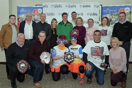 Saints rugby star, Piers Francis (centre rear) with Cycle 4 Cynthia prizewinners