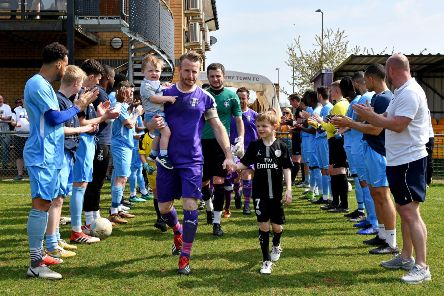 Rugby Town players and back room staff give Ross Harris and his Daventry Town team a guard of honour in Monday's derby. Photo: Martin Pulley