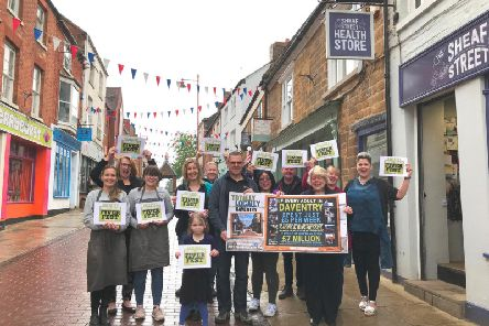 Some of Daventry's independent retailers, pictured here in Sheaf Street in town, getting ready for the Fiver Fest campaign this weekend.