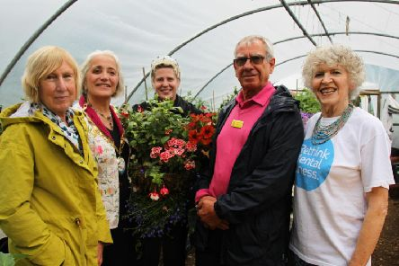 From left: NGS county organiser Gay Webster, Cllr Cecile Irving-Swift, Daventry Cummins employee and Green Health volunteer Kelly Walsh, NGS county organiser David Abbott and Sanchia Redston, of the Green Health Project, at their community allotment in Daventry.