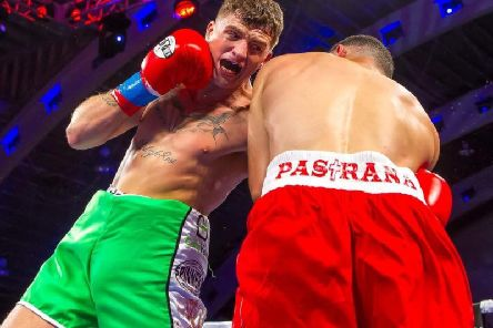 Connor 'The Kid' Coyle delivers a crunching left hook to the body of Danny Pastrana in his last outing.