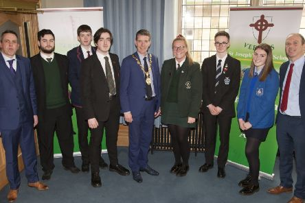 "The Mayor, Councillor John Boyle pictured with School Council�""s Representatives from schools who took part in Monday�""s ��Let�""s Talk�"" event at the Council Chambers, Guildhall. Included are St. Joseph�""s teachers, Mr. Peter Smith and Mr. Graeme Doherty."