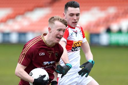 St Patrick's Bramdon Boyd takes on Conor McLaughlin of Cathair Dhoire in the Athletic Grounds on Monday.