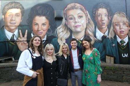 Derry Girls cast members Louisa Harland, Nicola Coughlan, Saoirse-Monica Jackson, Dylan Llewellyn, and creator Lisa McGee when they visited the 'Derry Girls' mural painted by UV Artists on the gable wall of Badger's Bar, Derry. (Photo Lorcan Doherty)