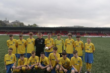 CHAMPIONS . . . St Columb's College U14s lift the Northern Ireland Schools Cup trophy at Brandywell.