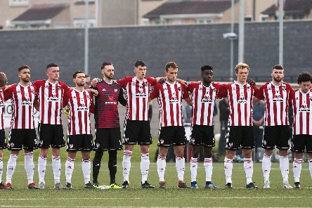 Derry City players honour a minute's silence for journalist Lyra McKee who was murdered in Creggan, on Thursday night.