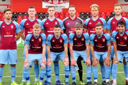 Derry City players in the club's 90th anniversary strip.