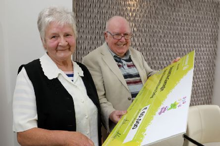 Donald McGonagle and wife Eileen from Greencastle, Co. Donegal celebrate at National Lottery headquarters in Dublin after they won the Telly Bingo Snowball prize of �60,000 on Thursday 11th July. The ecstatic couple who are married for over 55 years plan to enjoy their windfall by taking a sun-soaked cruise in the Mediterranean. The life-long Telly Bingo players bought their ticket at Farren's Newsagents in Moville, Co. Donegal.