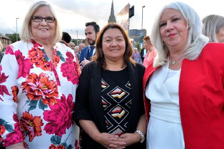 Cathy Healey, on the left and Christine Robson daughters of the late Sammy Devenny pictured with Mayor of Derry City and Strabane, Colr Michaela Boyle, at his memorial on William Street on Wednesday evening last.  DER2919GS-032